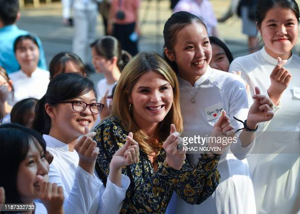 Jenna Bush Hager, daughter of former US president George W. Bush, poses for picture with Vietnamese student in Can Giuoc district, Long An province...
