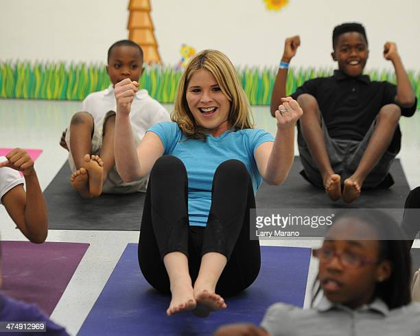 Jenna Bush Hager participates in a yoga class during a visit to the Gwen Cherry Park NFL/YET Center as First Lady Michelle Obama celebrates the 4th...