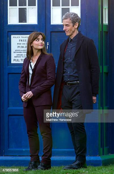 Jenna Coleman and Peter Capaldi stand in front of a tardis during filming for the eighth series of BBC show Doctor Who in Bute Park on March 18, 2014...