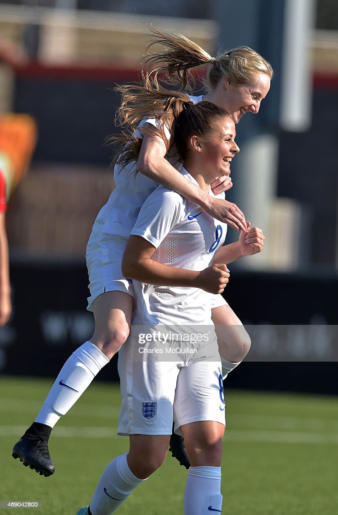 Jenna Dear (R) of England celebrates scoring during the UEFA U19 Women's Qualifier between England and Switzerland at Seaview on April 9, 2015 in Belfast, Northern Ireland.