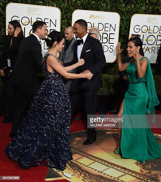Jenna Dewan Tatum and Jada Pinkett Smith arrive for the 73nd annual Golden Globe Awards January 10 at the Beverly Hilton Hotel in Beverly Hills...
