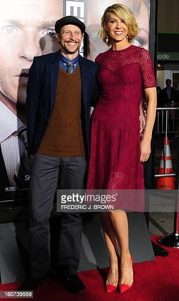 Jenna Elfman and her husband Bodhi Elfman pose on arrival for the World Premiere of the film 'Identity Thief' in Los Angeles California on February 4...