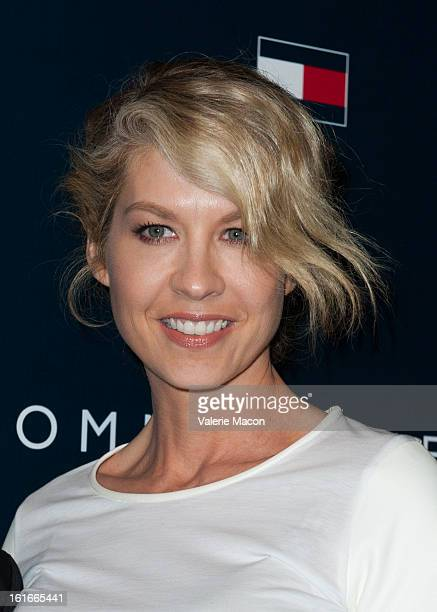 Jenna Elfman arrives at the Tommy Hilfiger LA Flagship Opening on February 13 2013 in Los Angeles California