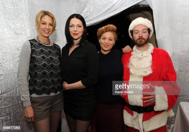 Jenna Elfman Laura Prepon Erika Christensen and Danny Masterson attend the Church of Scientology Celebrity Centre's 21st Christmas Stories at the...