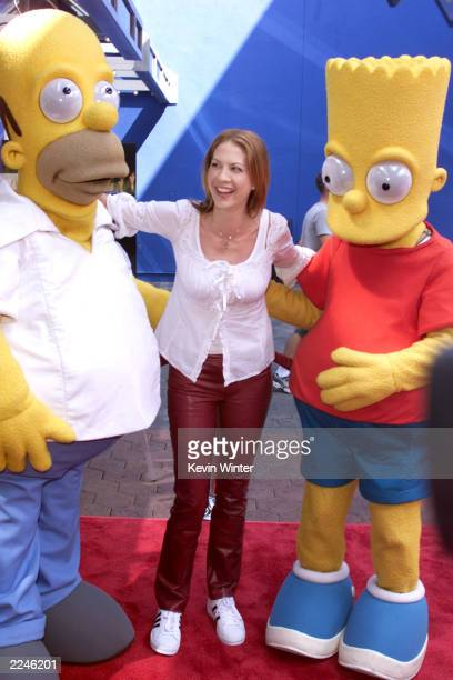 Jenna Elfman with Homer and Bart Simpson at the premiere screening of 'CYBERWORLD 3D' an IMAX 3D animated feature at Universal Studios IMAX Theatre...