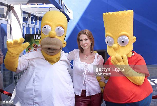 Jenna Elfman with Homerand Bart Simpson at the premiere screening of 'CYBERWORLD 3D' an IMAX 3D animated feature at Universal Studios IMAX Theatre at...