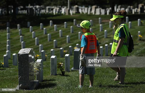 Jenna Gilbey of Elkridge Maryland and her brother Bryson read the name on a tombstone July 11 2016 at Arlington National Cemetery in Arlington...