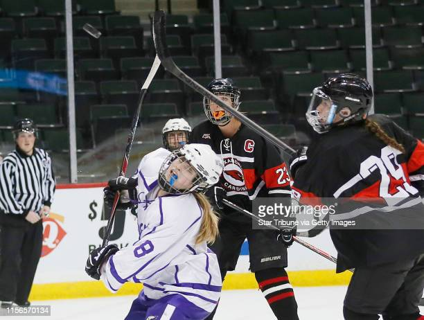 Jenna Gillund of Red Wing keep her eyes on the puck during the second peroid Red Wing played Alexandria in the Class 1A hockey quarterfinals at Xcel...