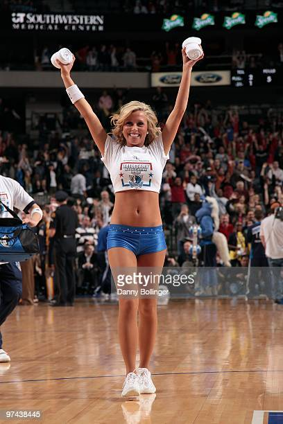 Jenna Gillund of the Dallas Mavericks dance team throws tshirts into the crowd during the game against the Indiana Pacers at the American Airlines...