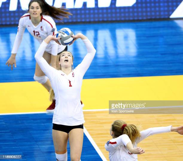 Jenna Gray of the Stanford Cardinals sets the ball for Holly Campbell during the NCAA Division 1 SemiFinal game against the Minnesota Golden Gophers...