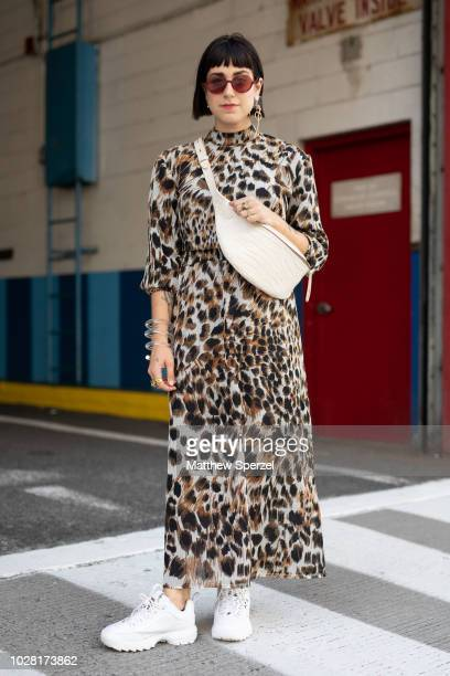 Jenna Igneri is seen on the street attending New York Fashion Week SS19 wearing a leopard print dress with crossbody bag and white sneakers on...