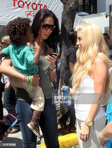 Jenna Jameson Kimora Lee Simmons and son Kenzo Lee Hounsou attend the 35th Annual Toyota Pro/Celebrity Race at the Long Beach Grand Prix on April 16...