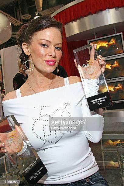 Jenna Jameson shows off the 11 AVN awards including Best Actress at the Club Jenna booth