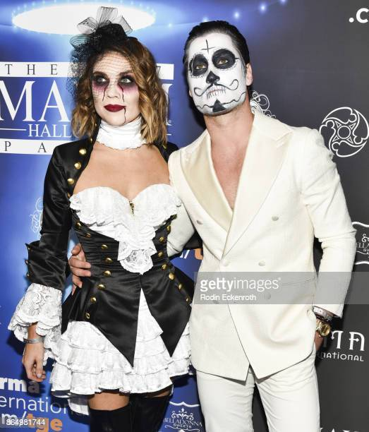 Jenna Johnson and Val Chmerkovskiy arrives at the 2017 MAXIM Halloween Party at LA Center Studios on October 21 2017 in Los Angeles California