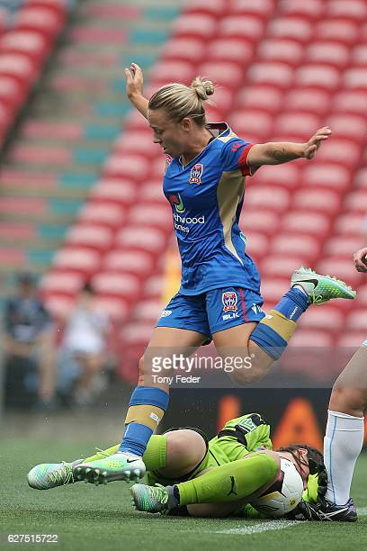Jenna Kingsley of the Jets leaps over the goalkeeper during the round five WLeague match between the Newcastle Jets and Sydney FC at McDonald Jones...