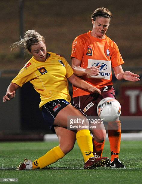Jenna Kingsley of the Mariners and Kate McShea of the Roar compete for the ball during the round three WLeague match between the Brisbane Roar and...
