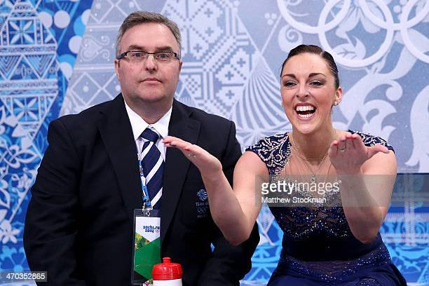 Jenna McCorkell of Great Britain waits for her score with her coach Simon Briggs in the Figure Skating Ladies' Short Program on day 12 of the Sochi...