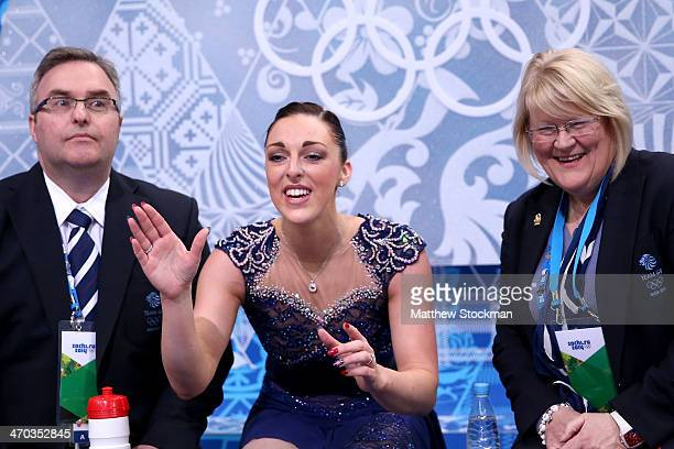 Jenna McCorkell of Great Britain waits for her score with her coaches Simon Briggs and Debi Briggs in the Figure Skating Ladies' Short Program on day...