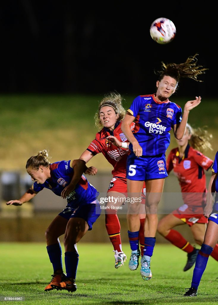 Jenna McCormick of Adelaide United and Erin Gilliland of Newcastle Jets during the round five W-League match between Adelaide United and Newcastle Jets at Marden Sports Complex on November 25, 2017 in Adelaide, Australia.