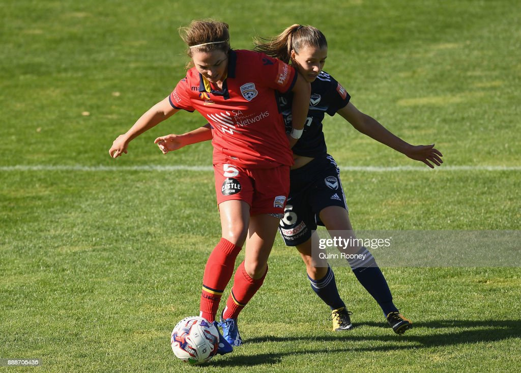 Jenna McCormick of Adelaide United and Lia Privitelli of the Victory compete for the ball during the round seven W-League match between the Melbourne Victory and Adelaide United at Lakeside Stadium on December 9, 2017 in Melbourne, Australia.