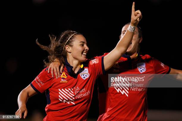 Jenna McCormick of Adelaide United celebrates with teammates after scoring a goal during the round 14 WLeague match between Adelaide United and the...