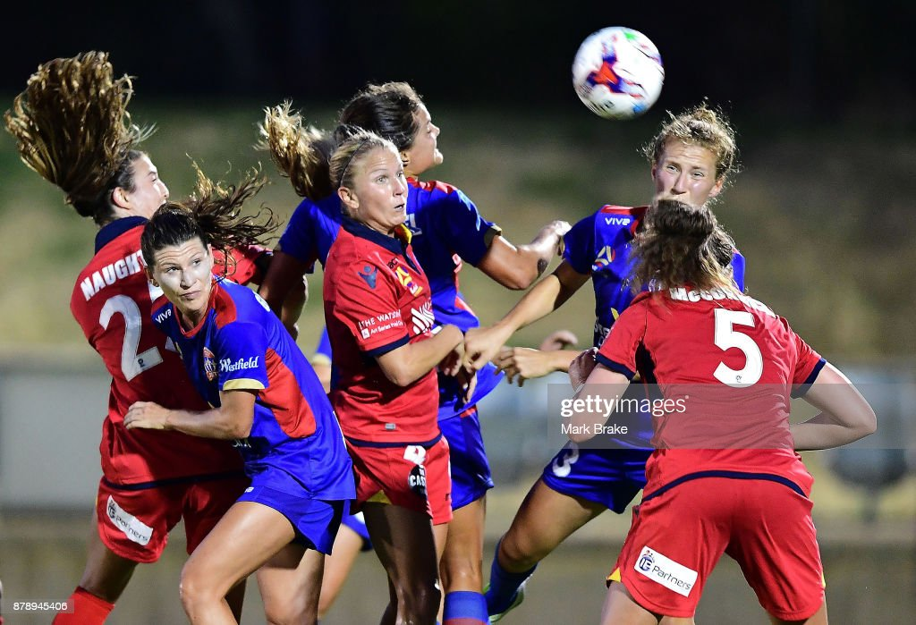 Jenna McCormick of Adelaide United gets her head to ball in the pack during the round five W-League match between Adelaide United and Newcastle Jets at Marden Sports Complex on November 25, 2017 in Adelaide, Australia.