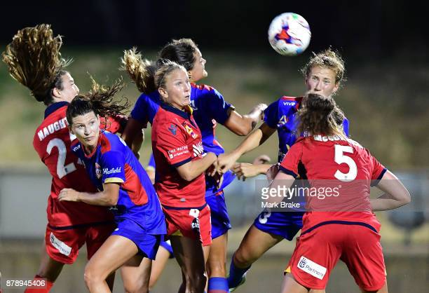 Jenna McCormick of Adelaide United gets her head to ball in the pack during the round five WLeague match between Adelaide United and Newcastle Jets...