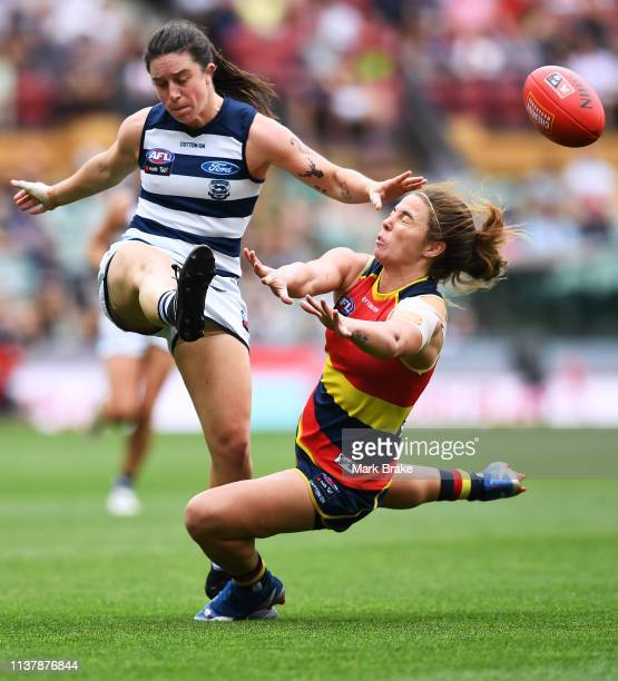 Jenna McCormick of the Adelaide Crows smothers a kick of Julia CrockettGrills of the Cats during the AFLW Preliminary Final match between the...