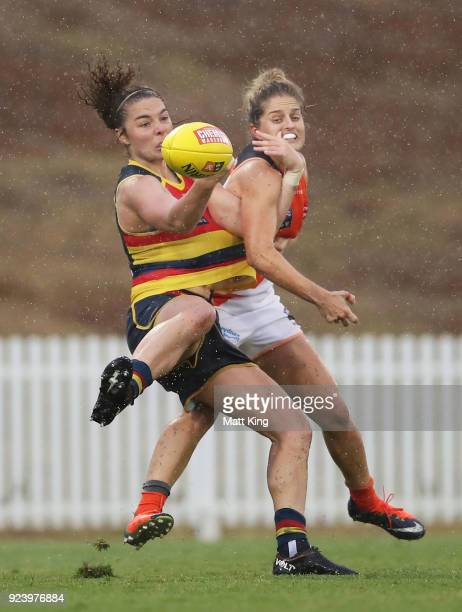 Jenna McCormick of the Crows competes for the ball against Ellie Brush of the Giants during the round four AFLW match between the Greater Western...