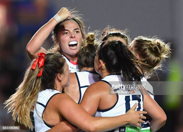 Jenna McCormick of the Crows is congratulated by team mates after kicking a goal during the round two AFL Women's match between the Western Bulldogs...