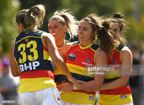 Jenna McCormick of the Crows is congratulated by team mates after kicking a goal during the round seven AFLW match between the Collingwood Magpies...