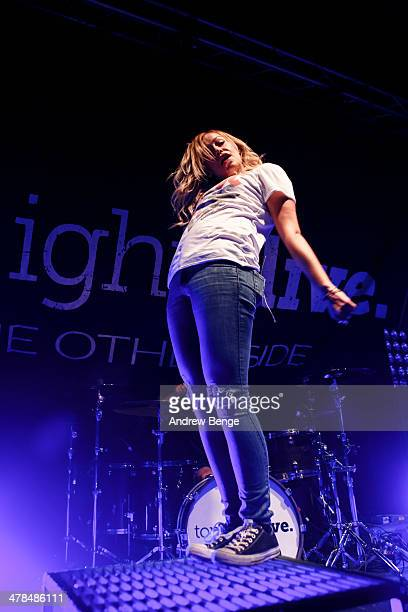Jenna McDougall of Tonight Alive performs on stage at Manchester Academy on March 13 2014 in Manchester United Kingdom
