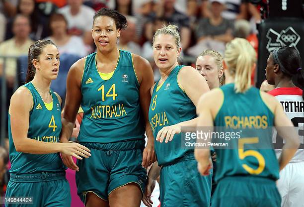 Jenna O'Hea Liz Cambage Suzy Batkovic and Samantha Richards of Australia celebrate after Cambage scored against Canada during the Women's Basketball...