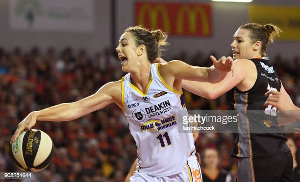 Jenna O'Hea of the Boomers attempts to regather the ball in front of Mia Murray of the Fire during game three of the WNBL Grand Final series between...
