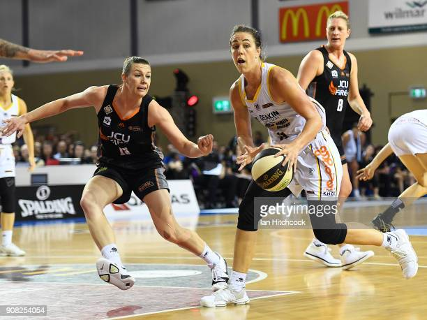 Jenna O'Hea of the Boomers looks to get past Mia Murray of the Fire during game three of the WNBL Grand Final series between the Townsville Fire and...