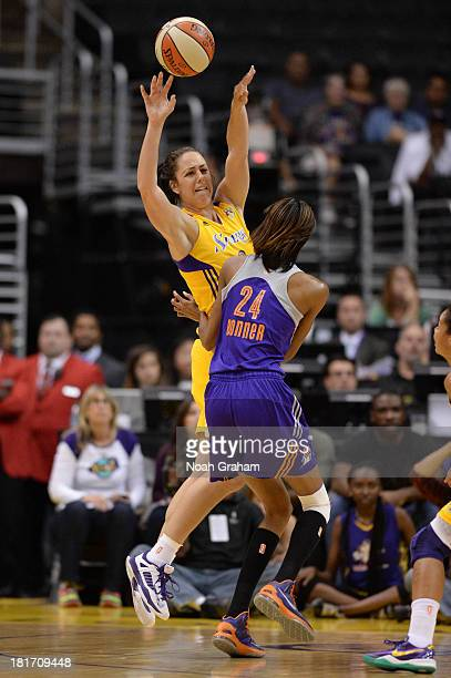 Jenna O'Hea of the Los Angeles Sparks passes against DeWanna Bonner of the Phoenix Mercury in Game Three of the Western Conference Semifinal of the...