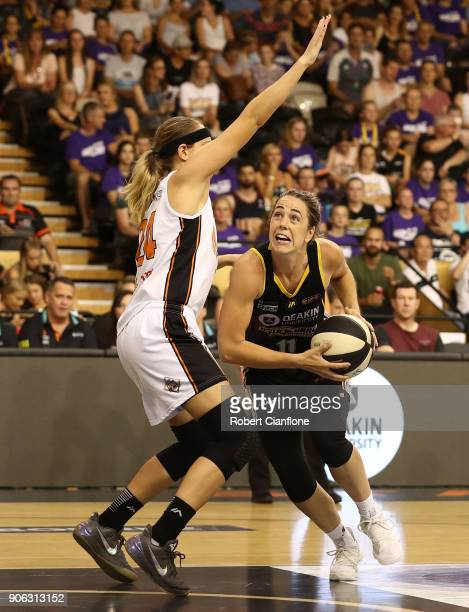 Jenna O'Hea of the Melbourne Boomers is challenged by Sydney Wiese of the Townsville Fire during game two of the WNBL Grand Final series between the...