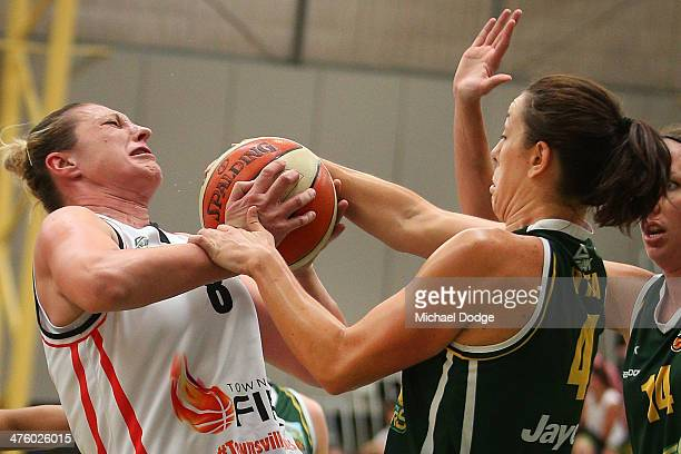 Jenna O'Hea of the Ranges and Suzy Batkovic of the Fire contest for the ball during the WNBL Preliminary Final match between the Dandenong Rangers...
