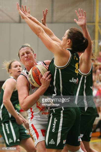 Jenna O'Hea of the Ranges blocks Suzy Batkovic of the Fire during the WNBL Preliminary Final match between the Dandenong Rangers and the Townsville...