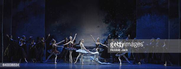 Jenna Roberts as Cinderella and William Bracewell as The Prince with artists of the company in Birmingham Royal Ballet's production of David...