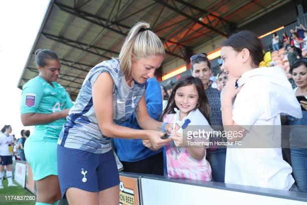 Jenna Schillachi of Tottenham Hotspur Women signs autographs during the Barclays FA Women's Super League match between Tottenham Hotspur and...