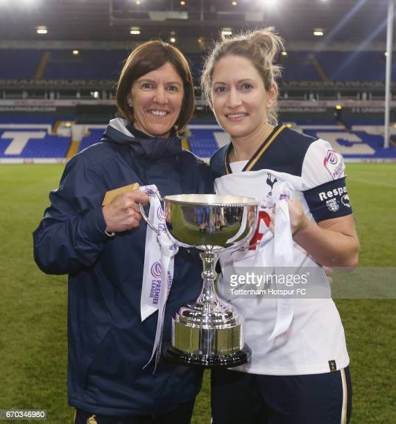 Jenna Schillaci of Tottenham and manager Karen Hills celebrate with the trophy for winning the FA Women's Premier League South Division title...