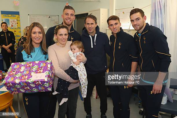 Jenna Schillaci Toby Alderweireld Tom Carroll and Vincent Janssen of Tottenham Hotspur pose for the camera with a young patient as they visit...