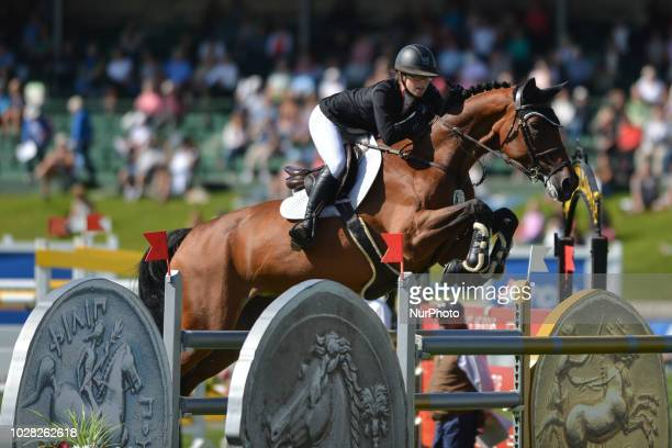 Jenna Thompson of Canada riding Lou 66 during the ATCO Founders Classic individual jumping equestrian event on the second day of the Spruce Meadows...