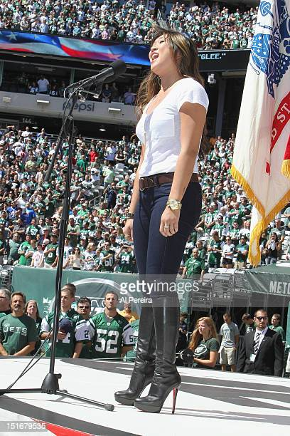 Jenna Ushkowitz performs the National Anthem at the Buffalo Bills vs New York Jets game at MetLife Stadium on September 9 2012 in East Rutherford New...