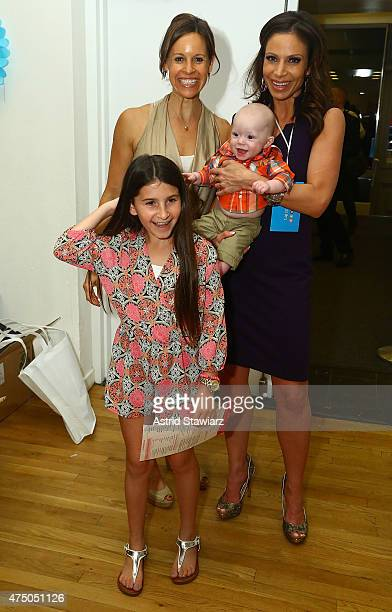 Jenna Wolfe Jill Nicolini holding son Austin Nicolini and Hallie Goldberg attend Big City Moms Biggest Baby Shower Ever NYC 2015 held at the...