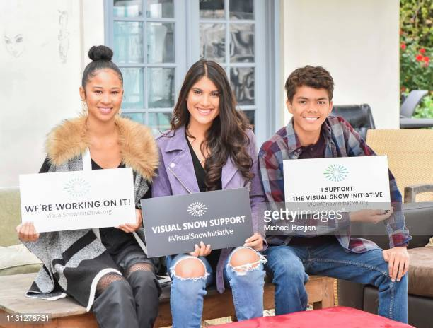 Jennalyn Ponraj Christina Cooper and Avery Franklin Davis pose with Visual Snow Initiative at Giveback Day at TAP The Artists Project on February 21...