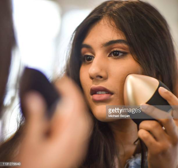 Jennalyn Ponraj using QYKsonic skincare device at at Giveback Day at TAP The Artists Project on February 21 2019 in Los Angeles California