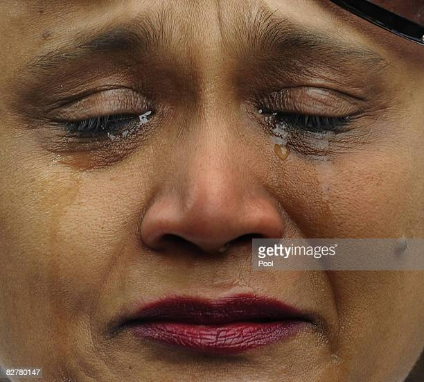 Jennhy Parbhu cries as she during the 7th annual 9/11 memorial ceremony at Zuccotti Park September 11 2008 in New York City Family and friends of the...