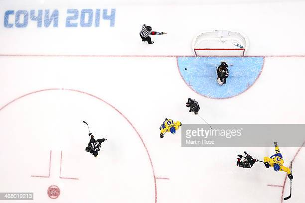 Jenni Asserholt of Sweden celebrates scoring the first goal during the Women's Ice Hockey Preliminary Round Group B Game on day two of the Sochi 2014...